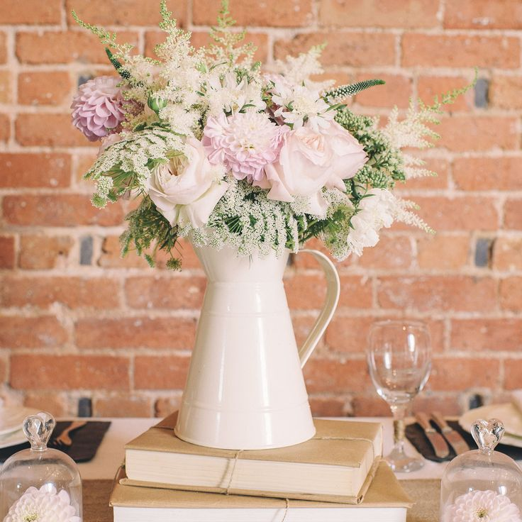 cream metal jugs wedding table decorations