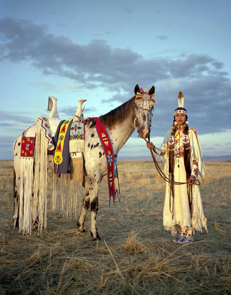 Kate Harris poses with her horse at the Happy Canyon Show in Washington state. The show celebrates Native American heritage and Old West history. Harris and her sisters, members of the old Chief Joseph Band, hand-make most of the traditional clothing, including the delicate beadwork. Photo by Erika Larsen. National Geographic.