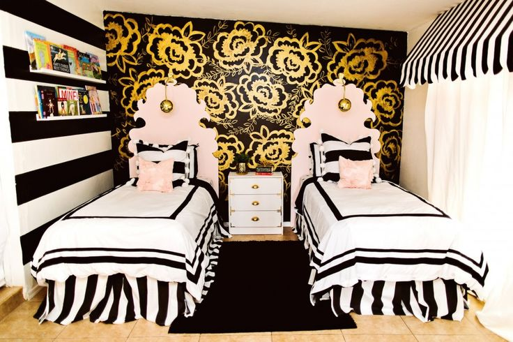 Gorgeous little girls room! Whimsical headboards, statement painted gold flowered wall, and classic black and white bedding! pink, black and gold