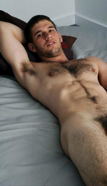 naked men in bed