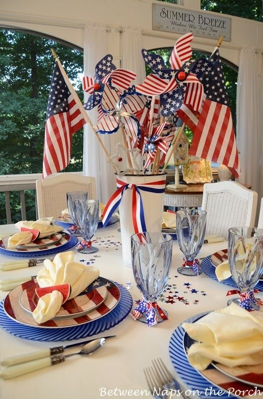 Cute outdoor patriotic table arrangement. Love the watermelons which are holding each napkin together.