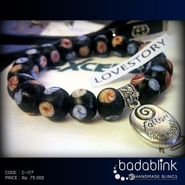 Black glassbeads bracelet with metal charm   Material: glassbeads and metal    Length: 18-22 cm/7-9 inches     Inquiries: facebook.com/badablink      Line: badablink      Email: hello@thebadablink.com