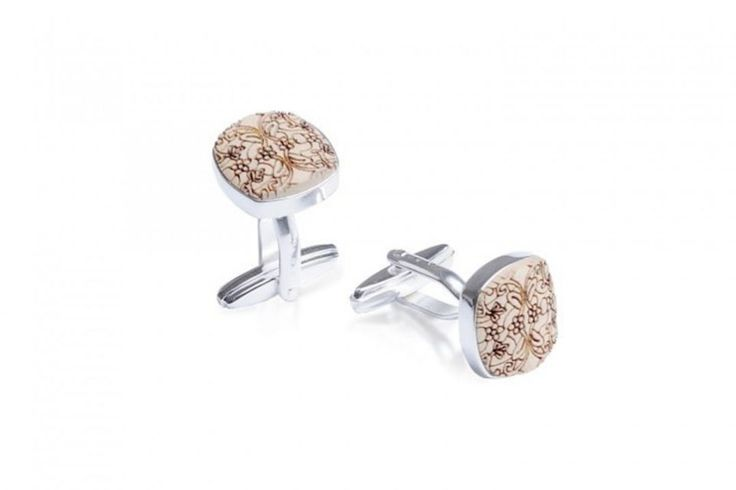 Revio Cuff cufflinks are an essential attribute to the gentleman's accessory collection. Crafted with passion from natural maple and finished with silver, this pair of wooden cufflinks adds masculinity to your outfit. Their rounded shape and the bullet back closure gives them the sense of perfection. This subtle add-on to your dress shirt is useful and light – at only ca. 6.8 grams – you won't even notice it! Choose the original laser engraved pattern for your perfectly ironed dress shirt…