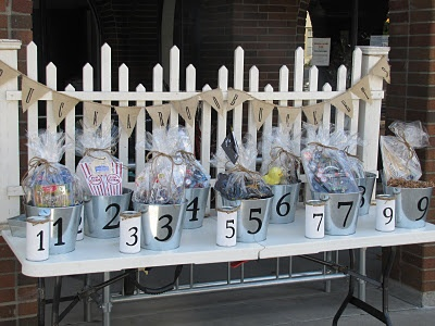 Raffle Table set up... I love the way this is set up with the numbered cans next to the numbered give-aways!  So neat & organized!!