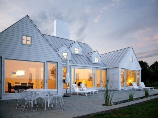 white modern clean farm house...dying...look at that patio, sunken  planter beds and those windows