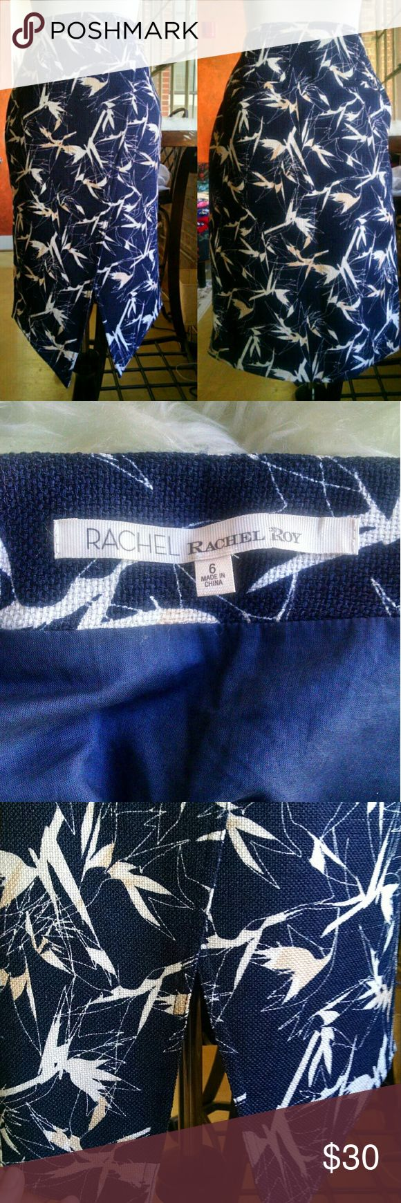 Lovely Navy Career Skirt Lined. Runs a tad small.  Has pockets!  Snaps on front.  Awesome hemline. RACHEL Rachel Roy Skirts