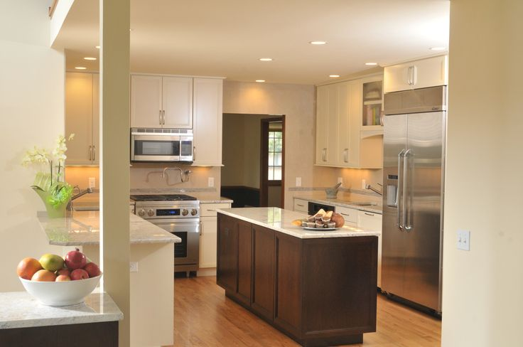 Secondary peninsula at column houses silverware & dishes and also becomes a serving buffet when entertaining!