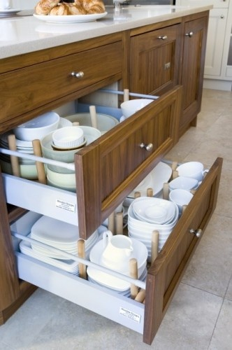 Big drawers, especially those with dish racks and other inserts, maximize bottom cabinets' storage potential.