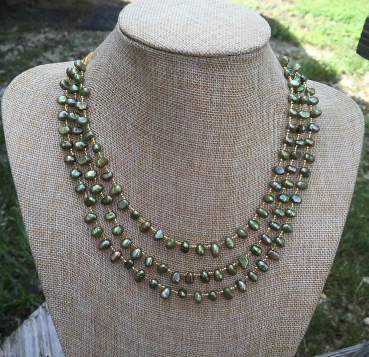 Olive green top drilled irregular shaped freshwater pearls evenly spaced with…