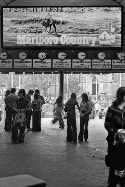 Flinders Street Station 1976 Melbourne Australia.  Cigarette advertising! Seems so wrong now, oh how times change.