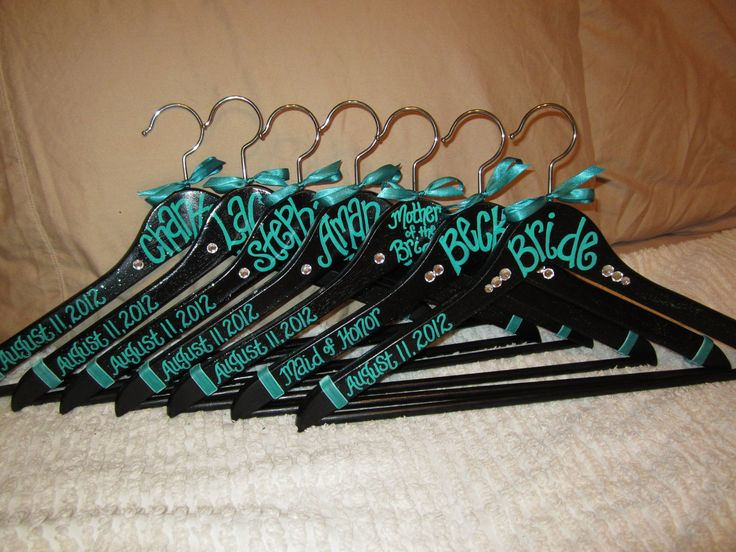 black + teal custom painted hangers for weddings and bridesmaids gifts. $9.75, via Etsy.