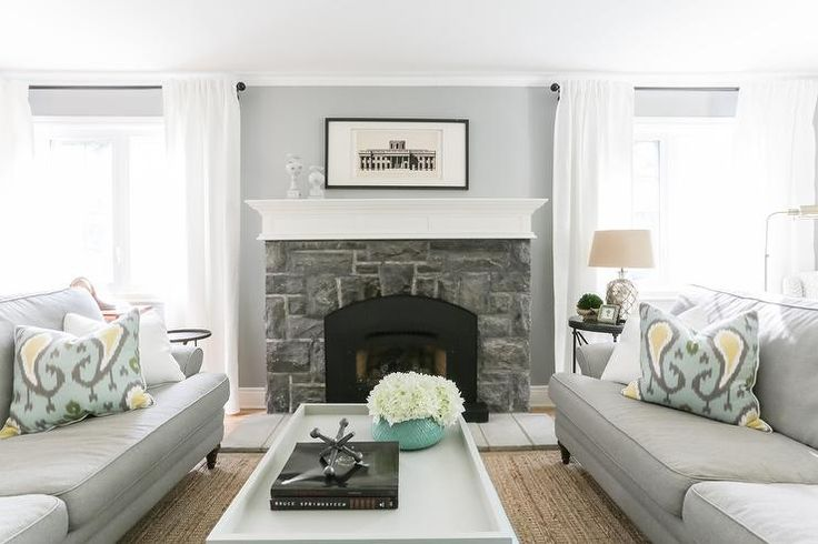 Gray Face To Face Sofas With Ikat Pillows Transitional