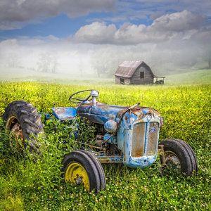 Tractor Rusty Photograph - Little Blue Tractor by Debra and Dave Vanderlaan