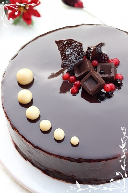 Berry Chocolate Mousse Cake - Ingredients for Cocoa Sponge Cake:4 eggs,120 grams of sugar,100 grams of flour,20 grams of cocoa powder,a pinch of salt. Berry Mousse:200 grams of mixed berries,120 grams of caster sugar,8 grams of gelatin(4 sheets),350 ml of double cream.Cream and whiskey Cream Mousse:4 egg yolks,50 grams of caster sugar,60 ml of milk,10 grams of gelatin(5 sheets),50 ml of whiskey cream(Bailey's),400 ml of double cream ,1 vanilla pod sugar,75 grams of cocoa powder,8 grams of...