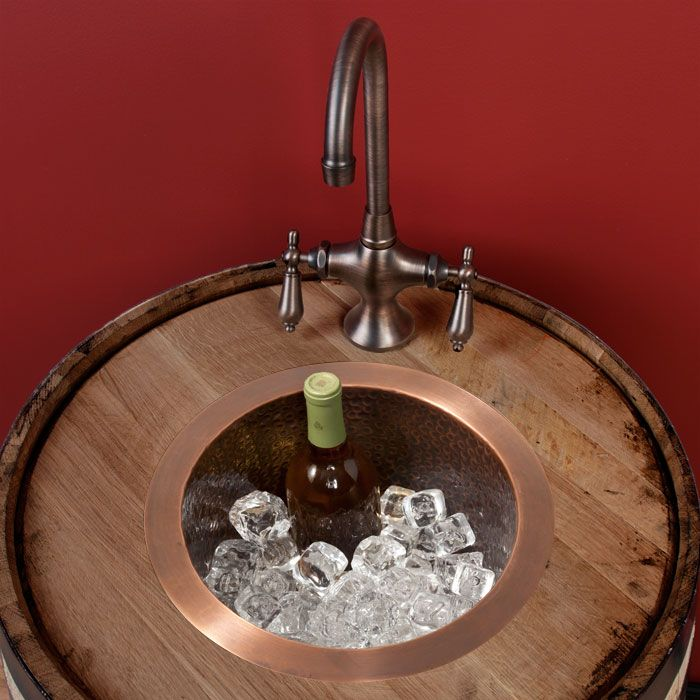 hammered copper bar sink, gotta have it! and a wine barrel stand! <3