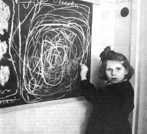 "pinner writes: POLAND. 1948. Teresa, a child in a residence for disturbed children, grew up in a concentration camp. She drew a picture of ""home"" on the blackboard."