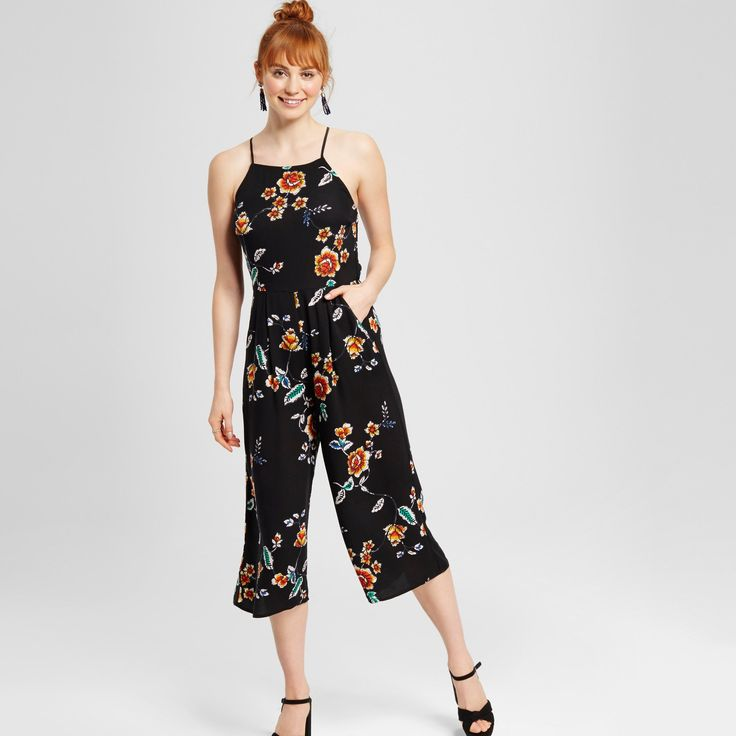 Playing with trends, the Women's Floral Jumpsuit in Black by Xhilaration™ (Juniors') has dynamic success. This strappy capri length romper makes a statement from top to bottom.<br><br>Used to Women's sizes? Size up in Junior's or check the size chart to determine best fit.