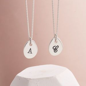 Solid Silver Personalised Initial Necklace - a unique take on an initial pendant each one has a silver organic shape and comes with a choice of two stylish fonts.    Go traditional monogram or use a modern typewriter font.  All solid silver.  All handmade.  All for you!