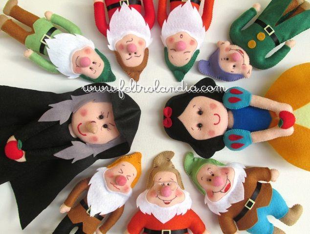 Bonecos da Branca de Neve e os sete anões para decoração de festa infantil.    www.feltrolandia.iluria.com