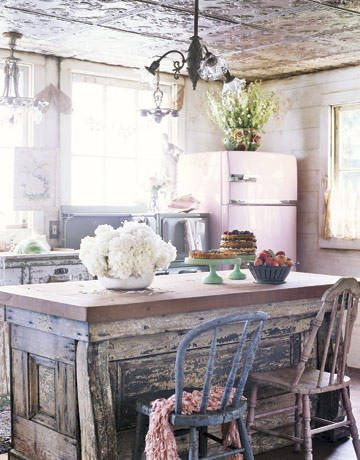 Rustic Kitchen Island..Victorian chandeliers, vintage china, and farmhouse chairs are just some of the essential items in a shabby chic-style kitchen. (Would LOVE to have that pink fridge!