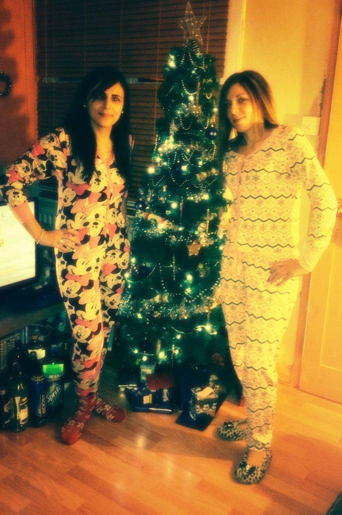 Christmas onesie sisters