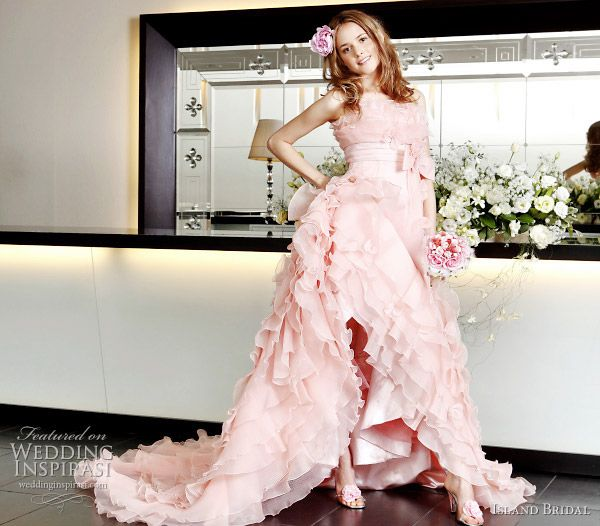 Sweet pink wedding gown with slit by Island Bridal
