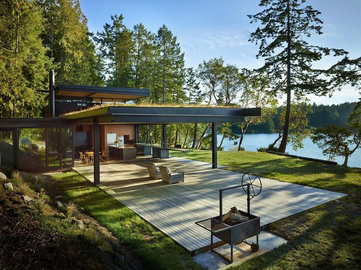 An Intimately Designed Retreat By Olson Kundig Architects Lies Nestled On A  Dense, Wooded Shoreline