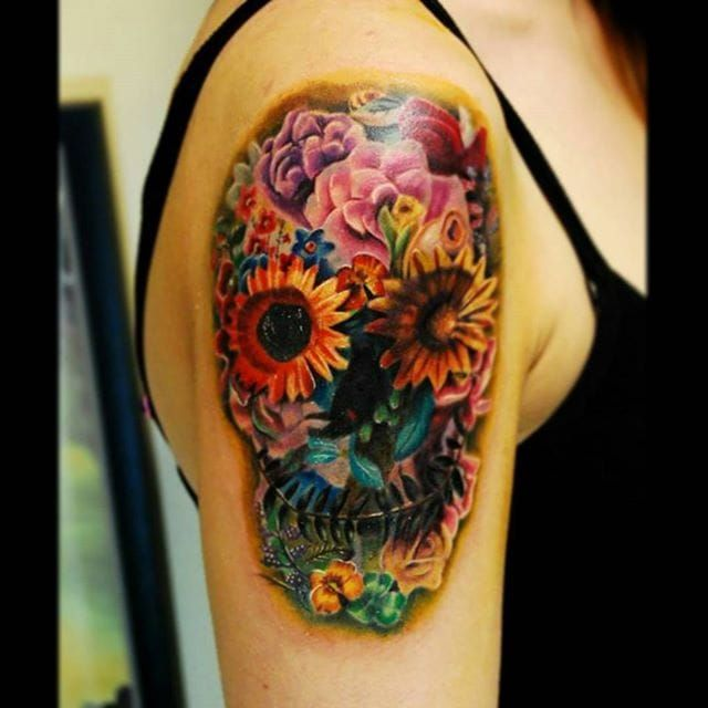 Color realism flower skull tattoo by Justin Buduo. realism colorrealism JustinBuduo flowers skull