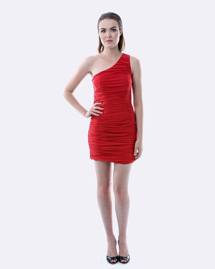 SKIVA One Shoulder Ruching Dress. Using a soft stretch fabric, this dress fits snugly to the body giving it shape and contour. A one shoulder design the dress features a striking all over ruching effect giving it a cascading look. A great dress which adjusts to your shape. Will be a winner at any cocktail party, or social event. Available in Red or White