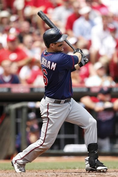 Josh Willingham #16 of the Minnesota Twins hits a two-run home run in the ninth inning against Aroldis Chapman #54 (not pictured) of the Cincinnati Reds during an interleague game at Great American Ball Park on June 24, 2012 in Cincinnati, Ohio. The Twins won 4-3.: Cincinnati Red