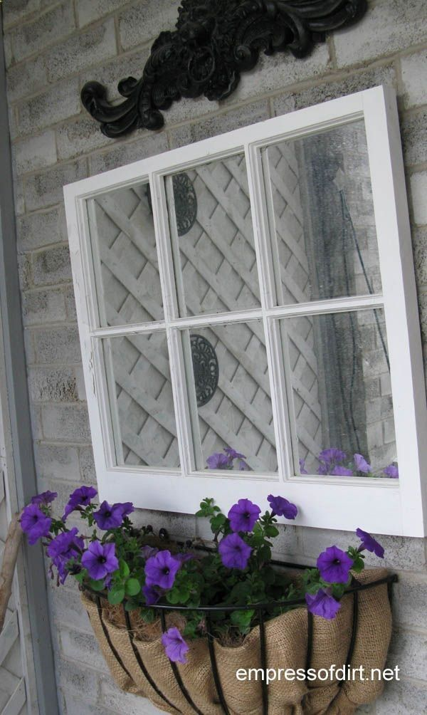 Old window with mirror added over planter with burlap liner