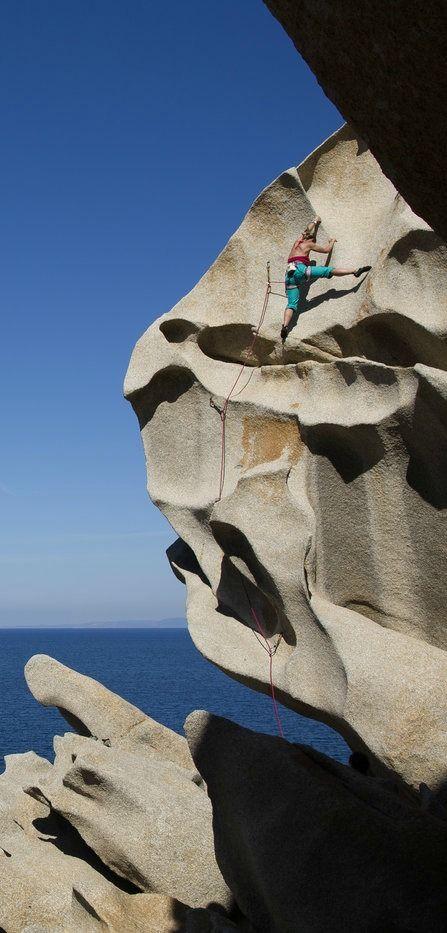 Carole Rattaggi scaling the unique formations of Capo Testa in the north of Sardinia.