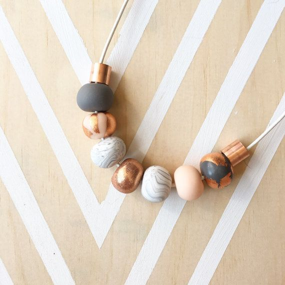 Welcome to Raf & Hop  Here we have a beautiful handmade polymer clay necklace. 9 beads on 80cm necklace of your choice. Compromising of marble, nude, grey, copper glitter and copper metal beads our sophie necklace is perfect to glam up any outfit! Only $ 6 shipping  Custom orders welcome!  Raf & Hop