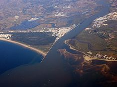The mouth of the Guadiana river and the city of Vila Real de Santo António (center). Also Monte Gordo (left), Castro Marim (upper center), Ayamonte (upper right) and Isla Canela (lower right)
