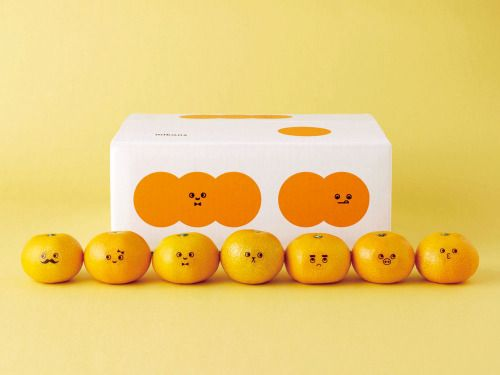 A Japanese company which sells satsumas (mikan) adorned with faces. LOVE. The branding was by Maru Work.