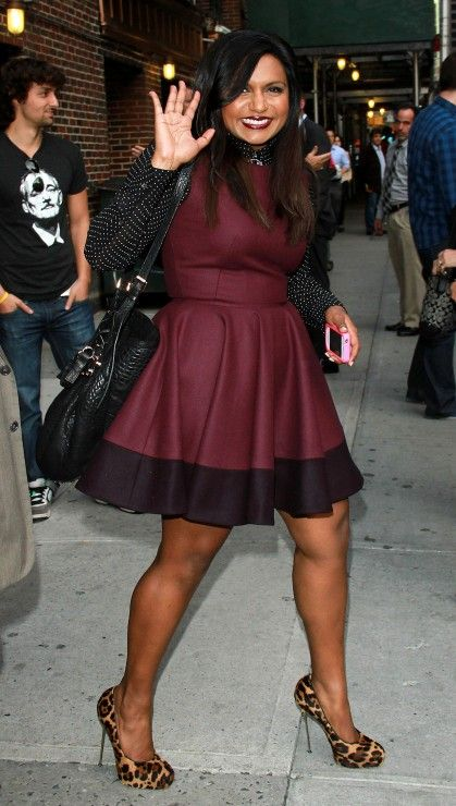 Mindy Kaling in a skater dress with a polka dot blouse under. I like the mix with leopard heels too.