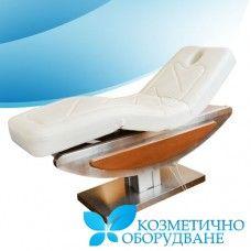 Елекрическо Козметично и масажно легло модел КС 2321 Функции: 1. Удобно и стилно легло с модерен дизайн и висока функционалност. 2. Приемане на ниско ниво на шум и дълъг живот на мотора.  3. Отвор за лицето. 4. Облегалката / поставка за краката може да се регулира до 30 градуса, височина може да се регулира с 60 см 80 cм с дистанционно.  5. Плътна метална и дървена конструкция.