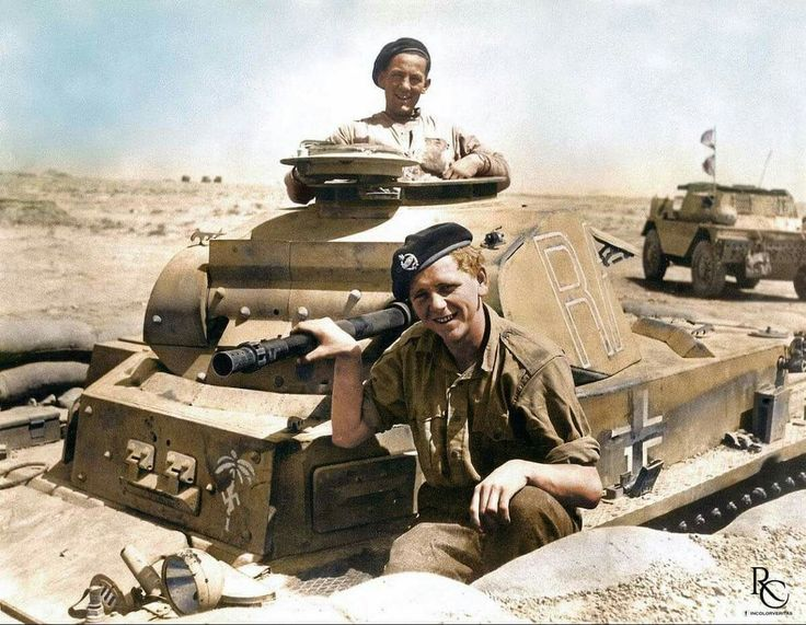 Allied soldiers posing on a captured Afrika Korps Panzer 2