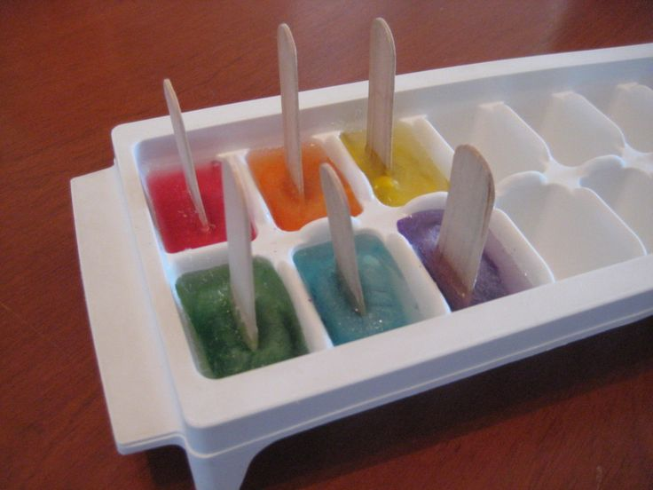 Iceberg painting... ice cube tray, paint, water, and popsicle sticks. Great for arctic or polar sensory play!