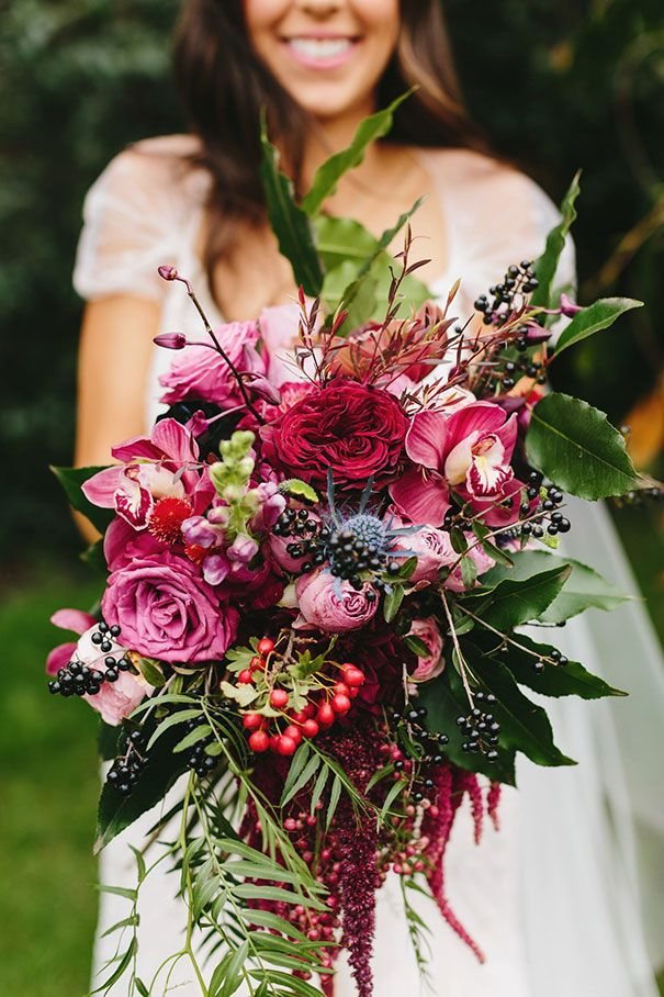 Beautiful bouquet of flowers & berries. Rich tones of pink finished off with dark berries.