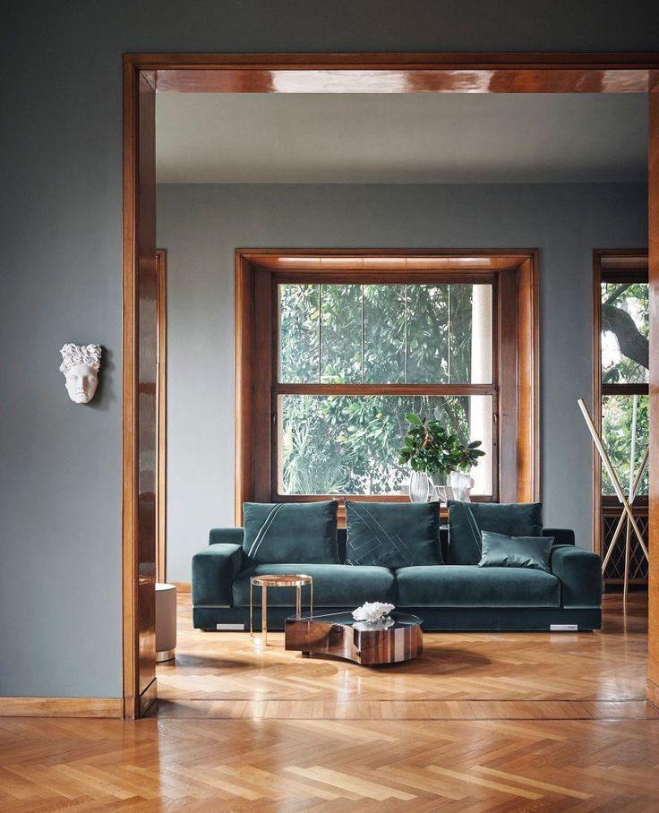 Teal sofa and parquet floors