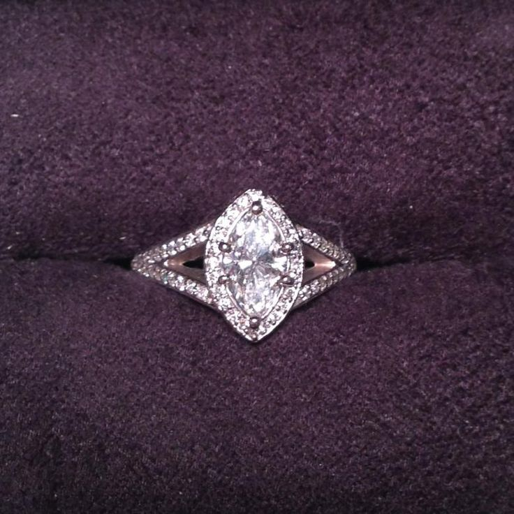 Bring back the Marquis Cut! This is a beautiful halo engagement/wedding ring. The center diamond is 1 carat and the surrounding setting has .75 carats of round brilliant cut diamonds. Please see the picture of appraisal for a more detailed description.