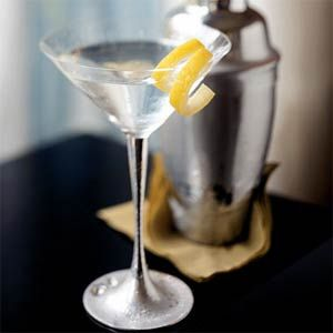 Dry Martini (Wet Martini=more Vermouth) - Cooled cocktail glass - add 2 1/2 shots Gordon's Gin and 1/2 shot dry vermouth to cocktail shaker and shake/stir to preference for 20 seconds - pour - garnish with lemon wedge