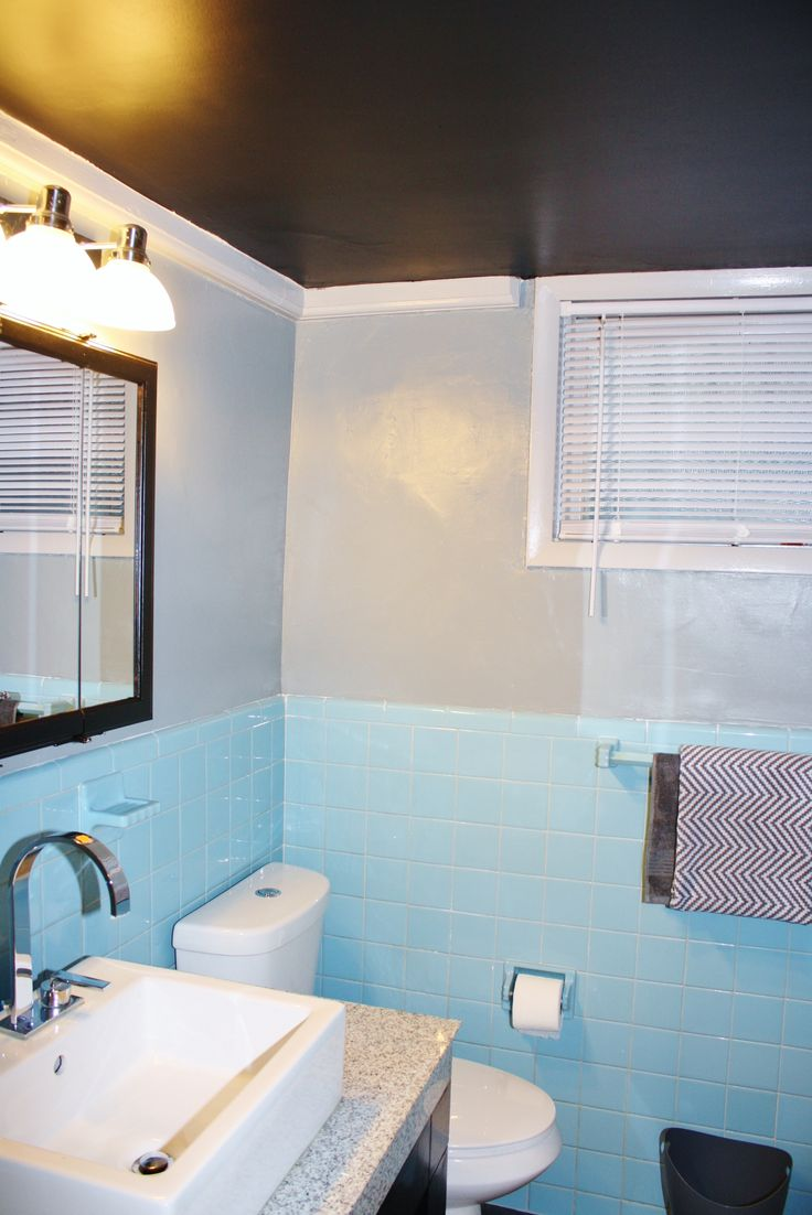 Updated men's basement bathroom.  Ceiling painted in beautiful black contrasting the gray paint and beautiful baby blue 70's tile.