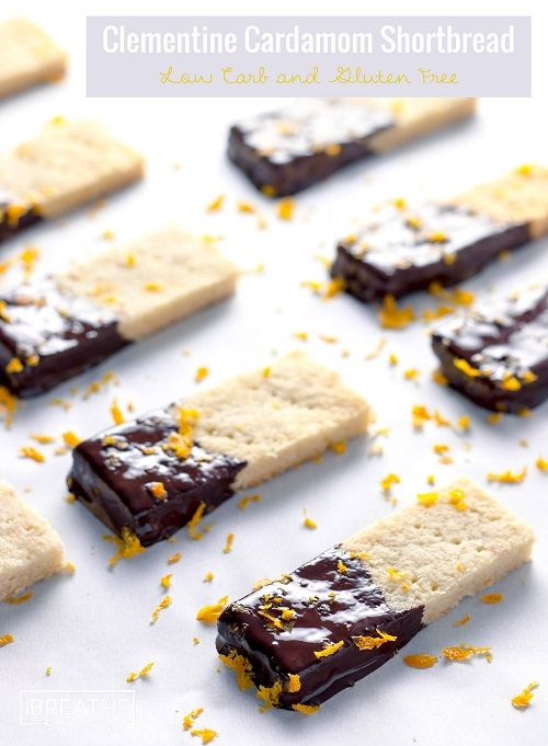 These delectable low carb shortbread cookies are flavored with cardamom and clementine zest, then dipped in dark chocolate! Gluten free too!