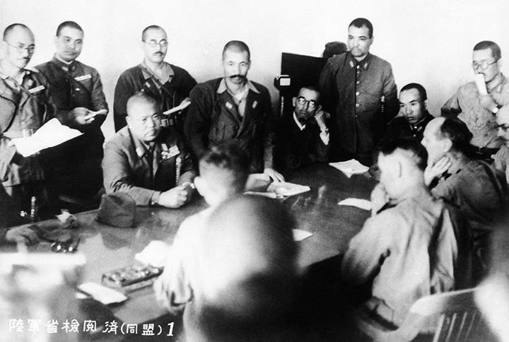 The conference at which Singapore surrendered on February 15 1942. Man seated at left facing camera is identified as Lieut. Gen. Tomoyuki Yamashita the Japanese Commander. Man in right foreground profile to camera is identified as Lieut. Gen. A. E. Percival British commander.