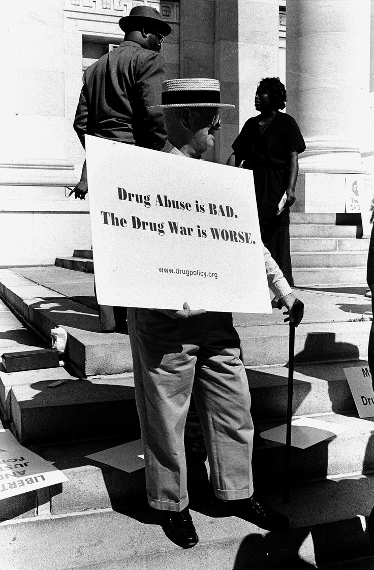 This man is holding a sign saying that the drug war is worse then the drug abuse. This is because it costs so much money to try to deal with combating drug abuse.