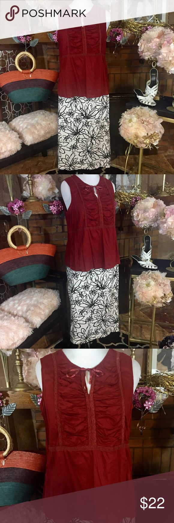 Cato Woman skirt; Venezia tunic Cato Woman black and white midi skirt with ruffle detail on back size 16. Approx measurements are 38 inch waist and 30 inches long. Venezia brick red tunic size 14/16. Approx measurements are 14/16. Outfit priced as a whole but can separate. $10 for top and $12 for skirt. Shoes and purse are for sale in another listing while available. Cato Skirts Midi