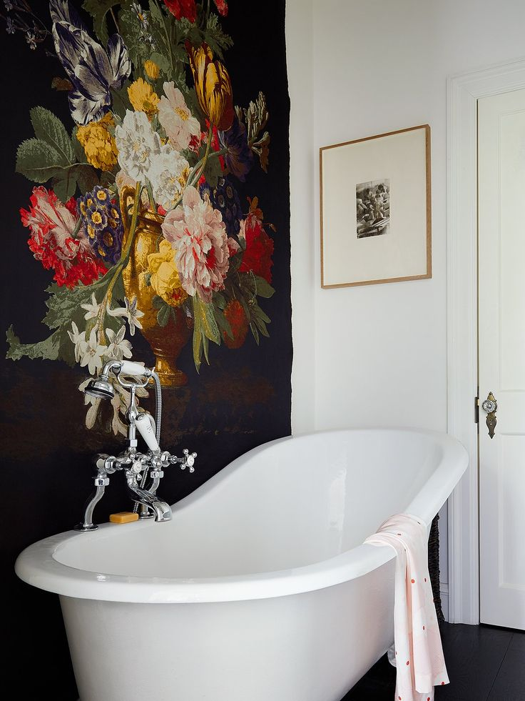 A floral tapestry backstops a clawfoot tub. Photographed by Kasia Gatkowska, Vogue, September 2016.