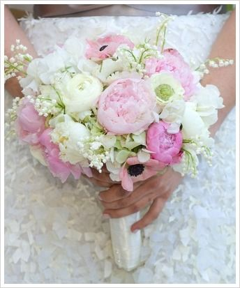 A spring bouquet of white and pink peonies, with white and pink anemones, lily of the valley and white hydrangeas.